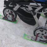 Детскоя коляска на лыжах